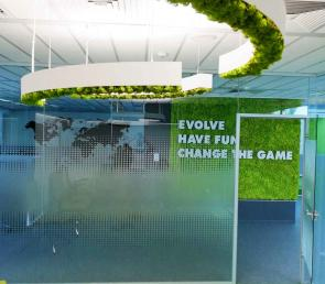 Green branded wall and office lamps from preserved moss